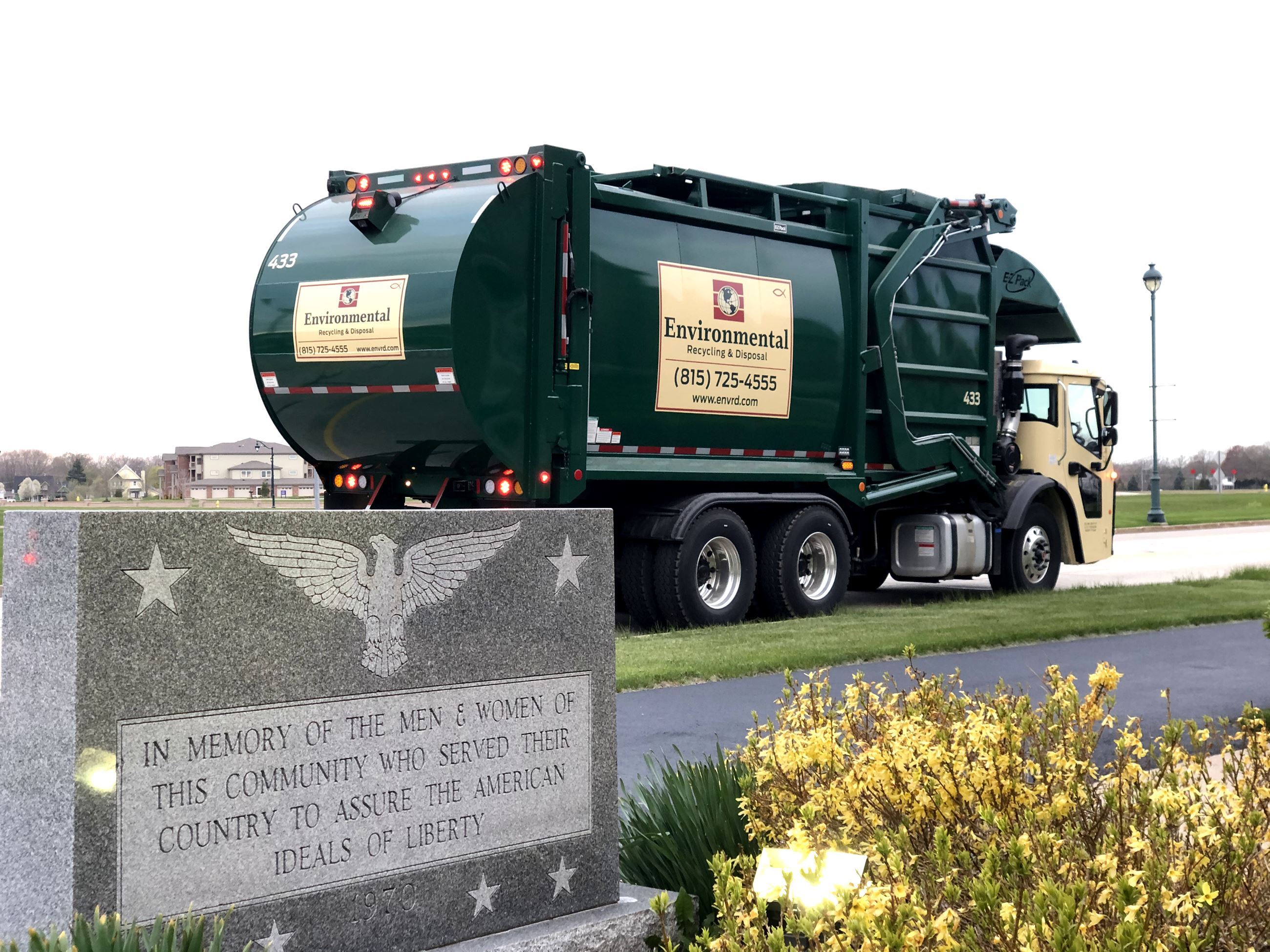Photo of Environmental Recycling & Disposal truck in front of Village Hall